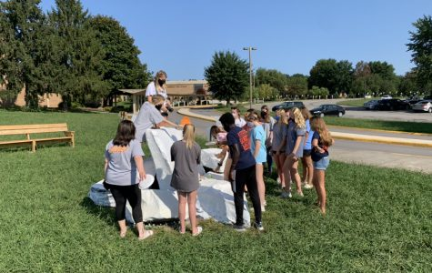 On September 7, 2020 Addie Grace Fields took this photo of ProjectU working together to paint the rock.