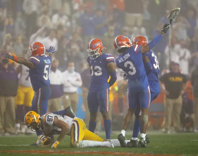 Florida cornerback Marco Wilson throws LSU tight end Kole Taylor's cleat after making tackle. Photo by Brad McClenny.
