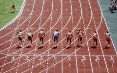 Track athletes running the 100 meter dash. Image from Canadian Running Magazine